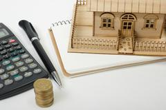 Concept of housing purchase and insurance. Office desk table with supplies top - stock photo
