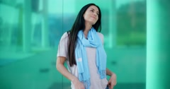 Happy woman looking sideways in front of glass - stock footage