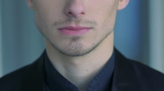 Close up of man's face, neck, lips and shirt. Slow motion Stock Footage