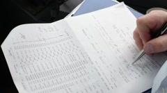Pilot fills the flight documentation - stock footage