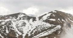 Rocky foggy mountain peak. 4k timelapse. Stock Footage