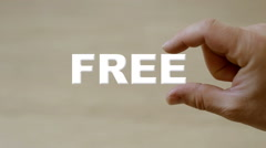 Hand holding the word free Stock Footage