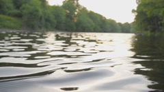 Closeup of river water at sunset in slow motion Stock Footage