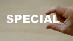 Hand holding the word special Stock Footage