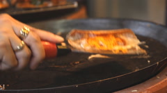 Chef preparing Thai crepe Stock Footage