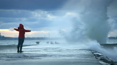 Woman standing near storm waves 4k Stock Footage