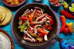 Chicken fajitas in a pan chili and sides Mexican Stock Photos