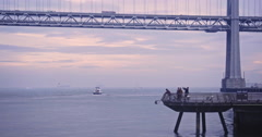 Aerial view of San Francisco Bay Bridge and Pier 14 Stock Footage