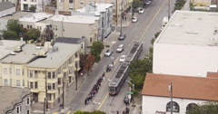 Aerial view of San Francisco Mission District intersection and Muni Tram Stock Footage