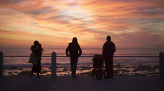 Silhouettes of people watching the sunset in Cape Town Stock Footage