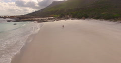 Aerial of Man Walking Alone on Empty Beach, Cape Town Stock Footage