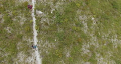 Aerial Looking Down on Two Hikers, Green Mountains, Pringle Bay Stock Footage