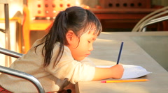 asian chidren and sister doing home work at home - stock footage