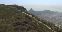 Aerial of Man Walking on Top of Table Mountain, Cape Town Stock Footage