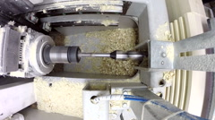 View of drill plunges into boards and shavings fly Stock Footage