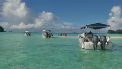 Tourists People Boats White Sand Tropical Paradise Beach Sea Palau - stock footage