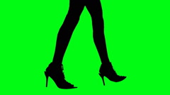 Female legs walking in silhouette green screen Stock Footage
