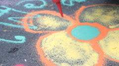 Colored sand drawing on street Stock Footage