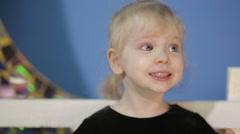 Funny Girl chews an apple - stock footage