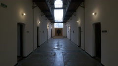View of a cross at the end of the prison's hallway at Sighet Memorial Museum Stock Footage