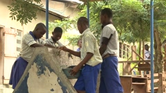 STUDENTS FILLING TUBS WITH WATER AT FAUCETS Stock Footage