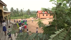 WIDE:  STUDENTS IN A SCHOOLYARD WITH GREEN AND RED HANDWASHING STATIONS Stock Footage