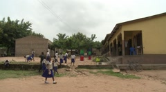 STUDENTS OUTSIDE OF SCHOOL- PAN TO SANITATION FACILITY Stock Footage