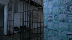 Wall with prisoners portraits and a hallway at Sighet Memorial Museum Stock Footage