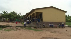WIDE: STUDENTS PLAYING - PAN TO STUDENTS IN FRONT OF NEW SANITATION FACILITY Stock Footage