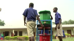 STUDENTS WALK AWAY FROM GREEN AND RED HAND-WASHING STATIONS Stock Footage