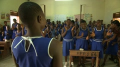 STUDENTS SINGING AND CLAPPING IN A CLASSROOM 2 Stock Footage