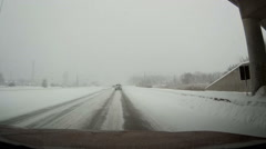 POV Dashcam driving in snowstorm and blizzard conditions Stock Footage