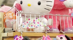 Kitty soft toy on the counter in the store Stock Footage