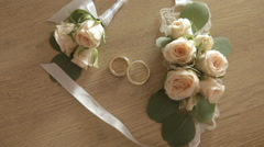Wedding rings newlyweds with flowers on a wooden background Stock Footage
