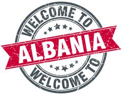 welcome to Albania red round vintage stamp - stock illustration