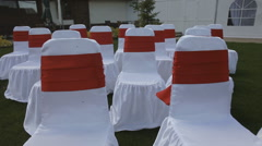 White chairs with red stripes outdoor Stock Footage