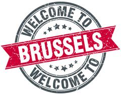 welcome to Brussels red round vintage stamp - stock illustration