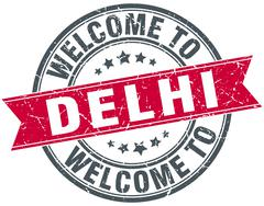 welcome to Delhi red round vintage stamp - stock illustration