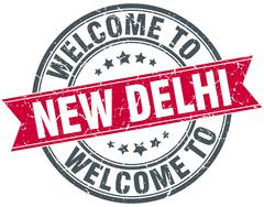 welcome to New Delhi red round vintage stamp - stock illustration