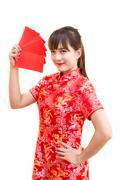 Beautiful Asian woman wearing traditional Cheongsam on chinese pattern - stock photo