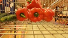 gathering paprika  in the supermarket trolly - stock footage