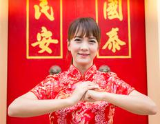 Happy Chinese new year. Cute Asian woman with gesture of congratulation Stock Photos