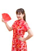Stock Photo of Happy chinese new year,Cute smiling Asian woman dress traditional cheongsam
