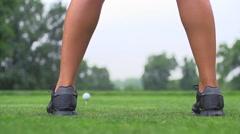 Girl beats a stick golf ball Stock Footage