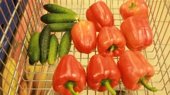 Fresh vegetables in the supermarket, red pepper and green cucumbers Stock Footage