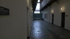 Passing by doors of Sighet Memorial Museum Stock Footage