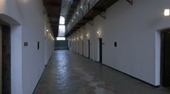View of the ground floor hallway and prison cells at Sighet Memorial Museum Stock Footage