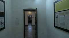 Entering in the Monarchy versus Communism room in Sighet Memorial Museum - stock footage