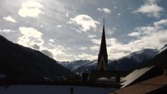 Fast Moving Clouds Time Lapse Over Austrian Alps Church Stock Footage