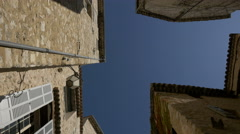 Low angle of stone buildings with a blue sky background in Tourrettes-sur-Loup Stock Footage
